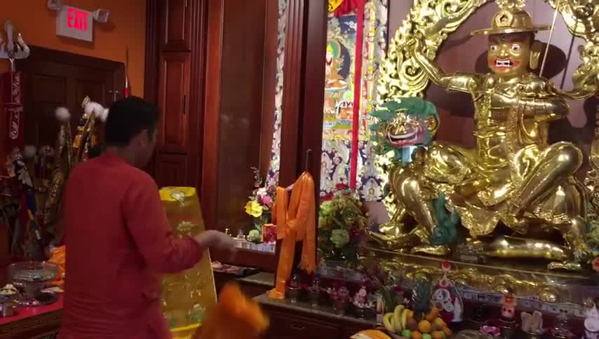 His Holiness Kyabje Trijang Rinpoche makes offering of khata to Dorje Shugden.